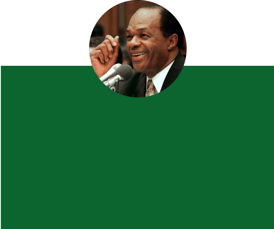 Circular image of Marion Barry over a green background